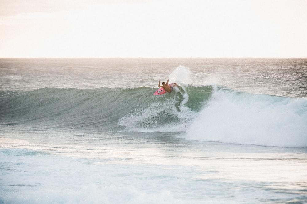 surfer on ocean wave during daytime