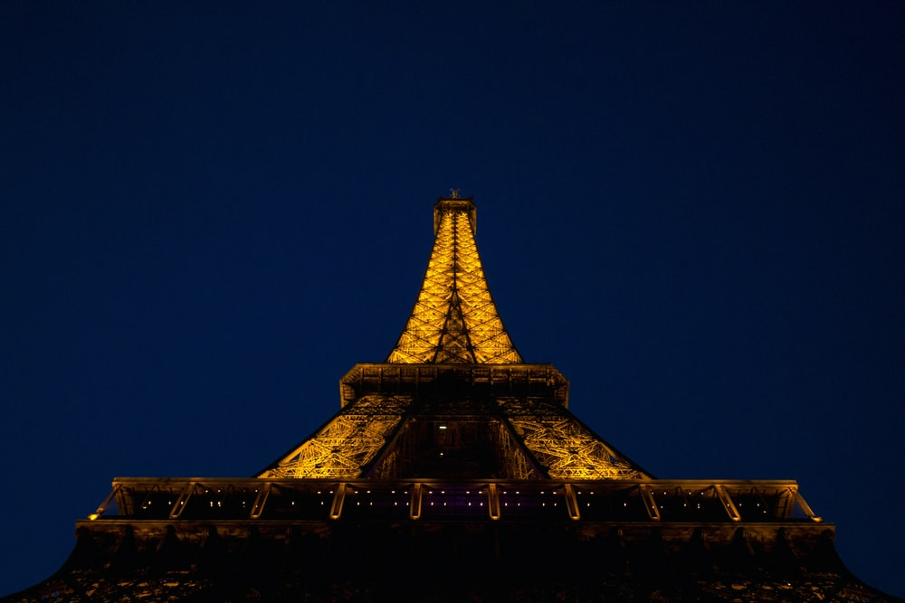 low angle silhouette of Eiffel tower under blue sky during night time