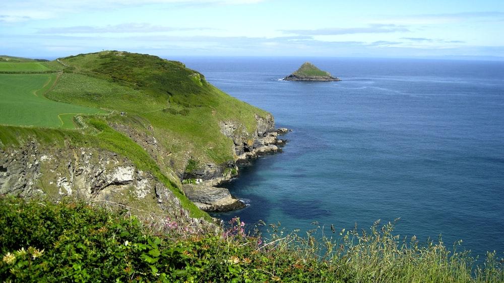cliff near seashore at daytime