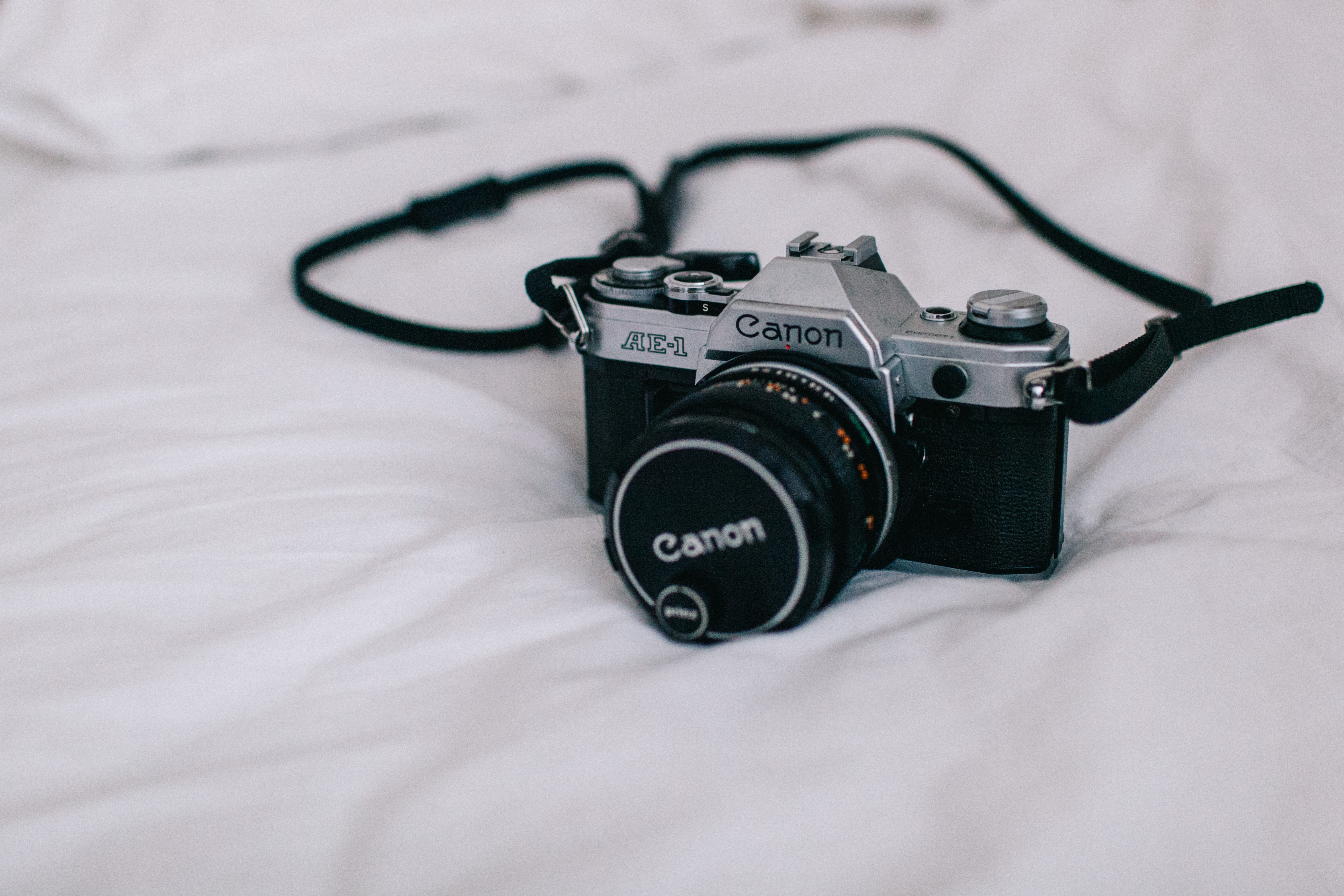 Vintage film canon camera on a bed