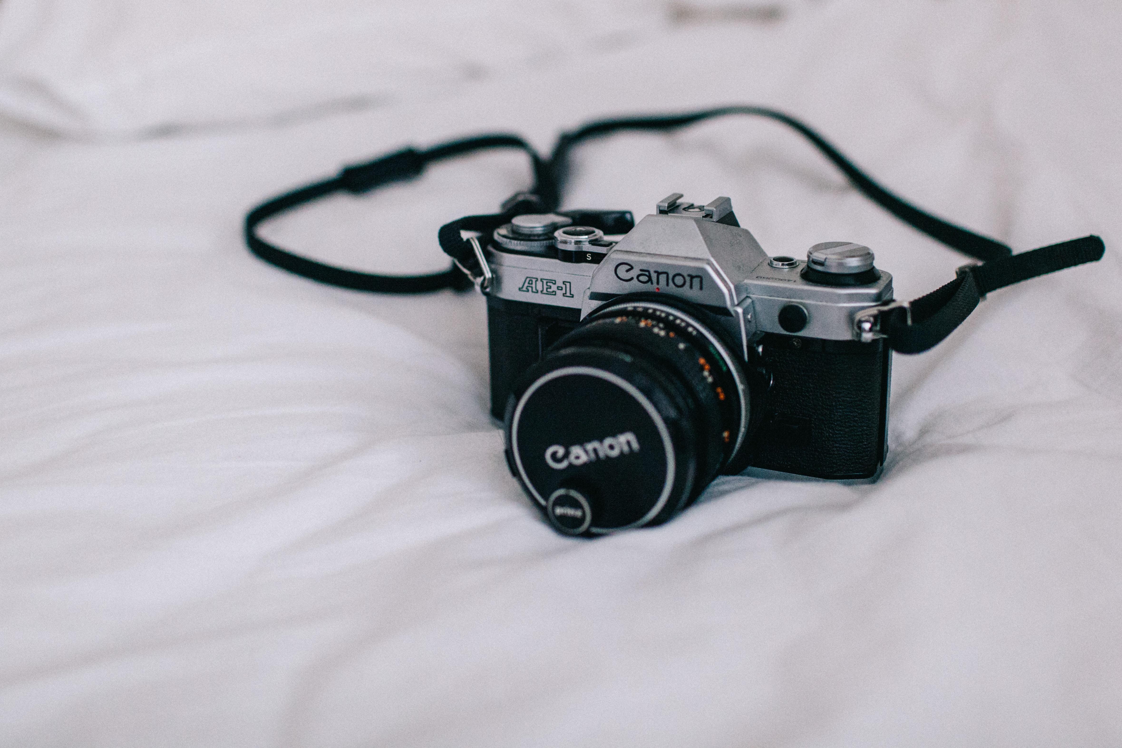 black and silver Canon DSLR camera