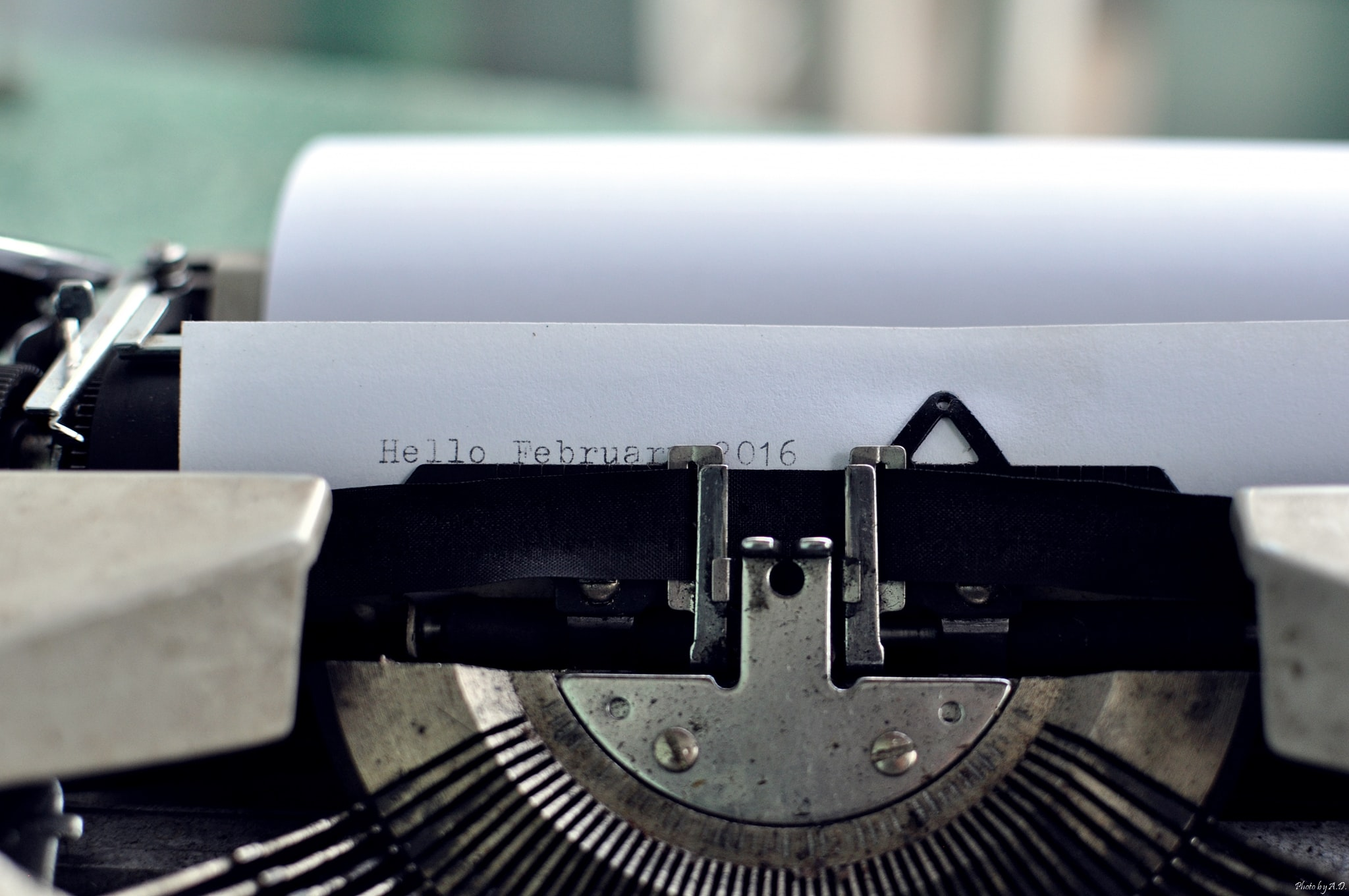 """Macro of typewriter ribbon and paper reading """"Hello February 2016"""""""