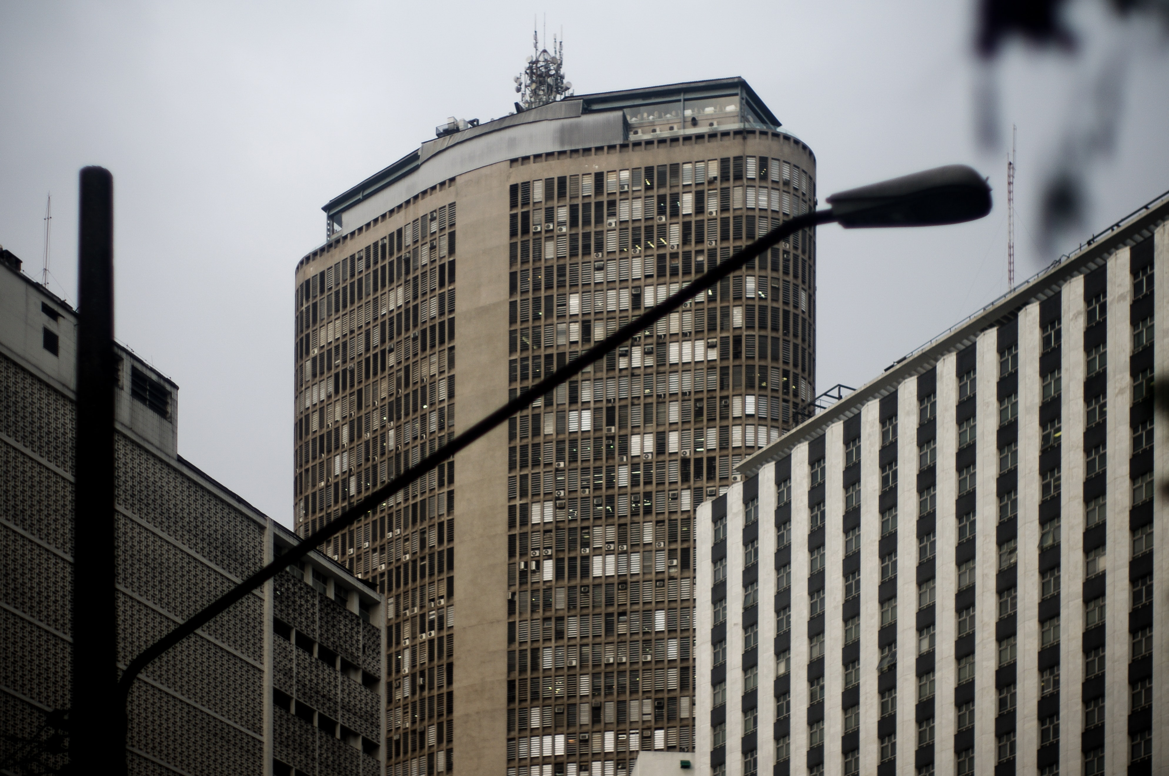 utility post near high rise building