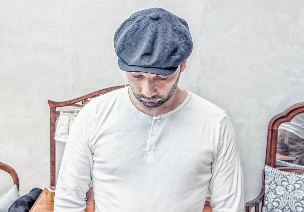 man wearing white henley shirt