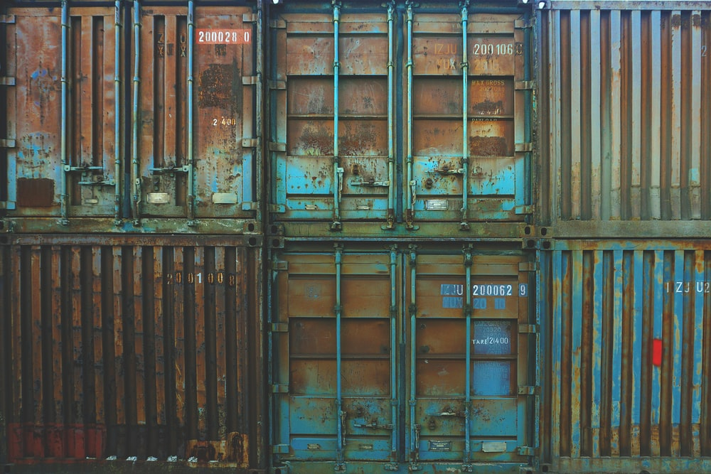 six blue freight containers