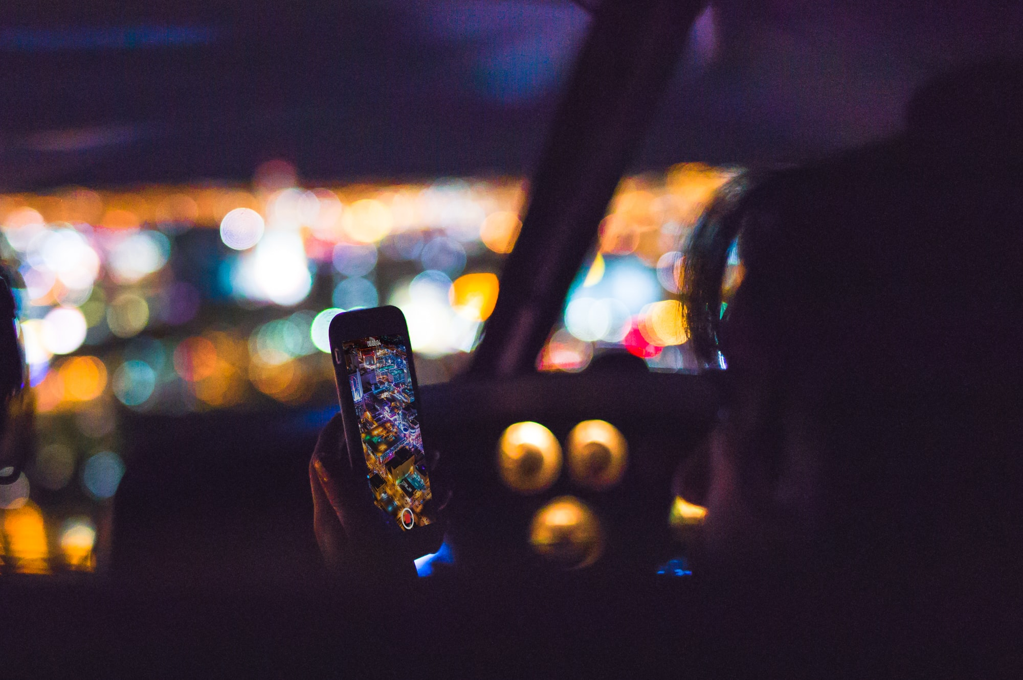 Night photography on iPhone with bokeh of lights of las vegas strip