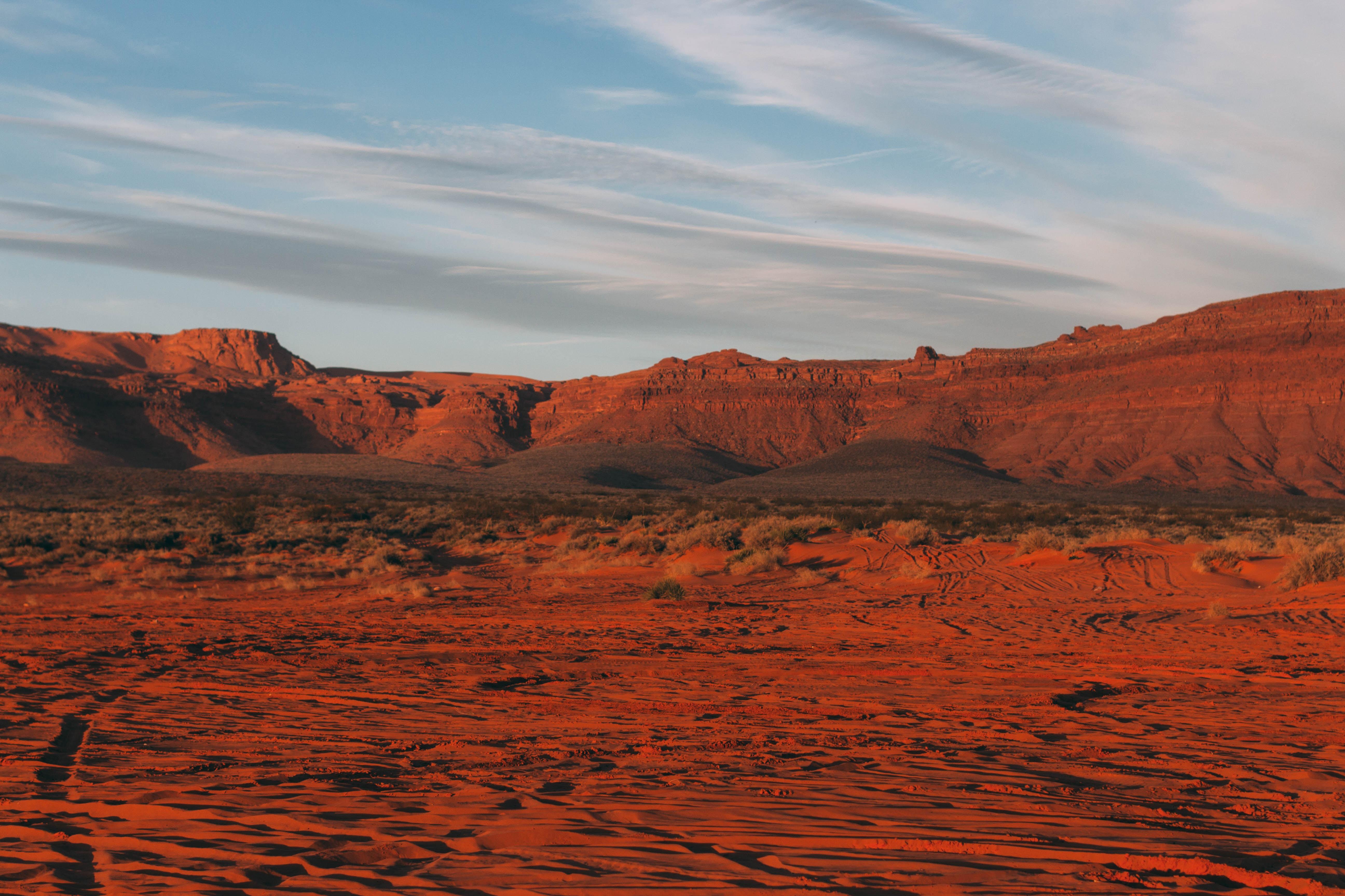 Red rock and sand in a barren desert terrain