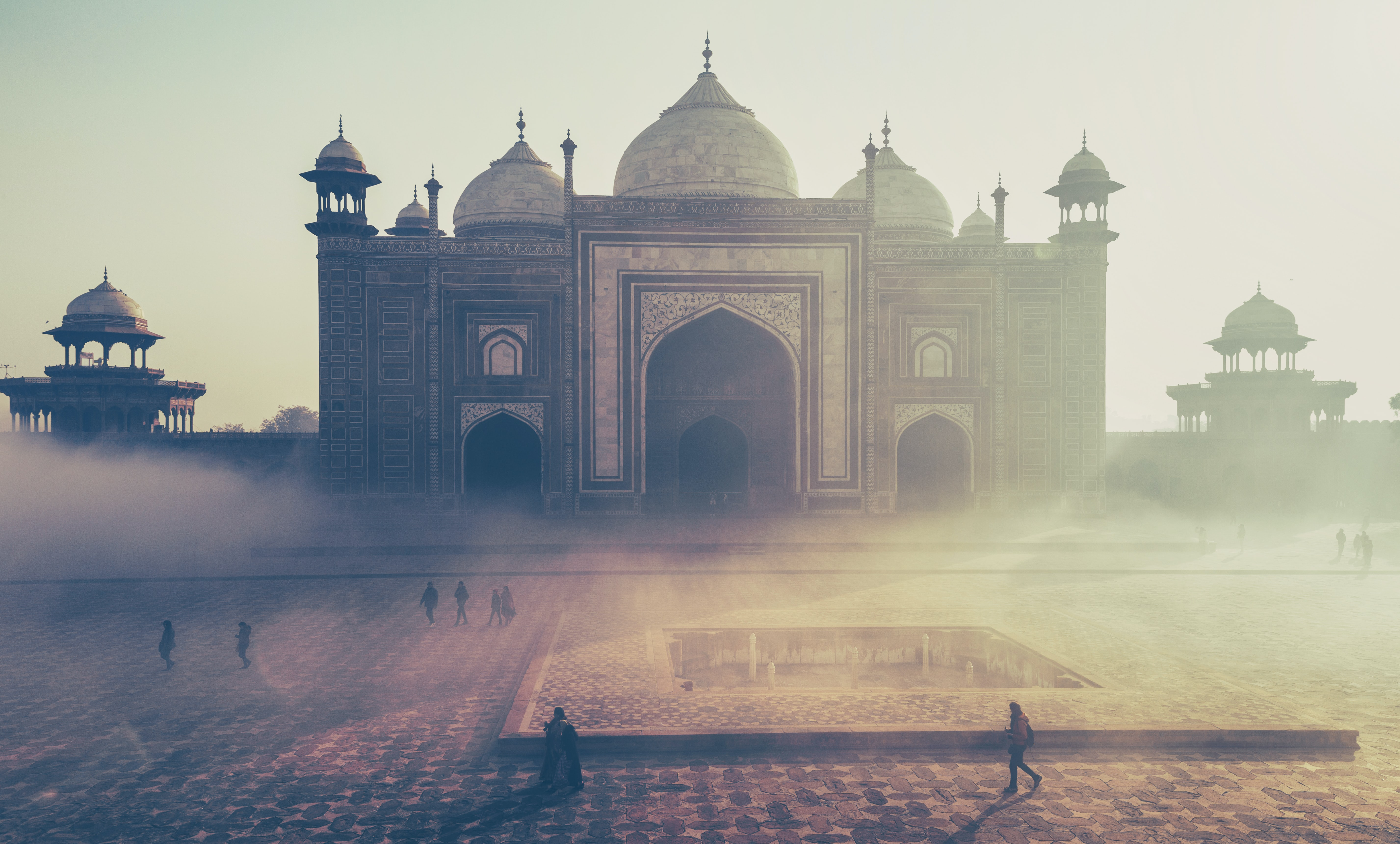 Tourist walk past ornate temples and architecture in Agra