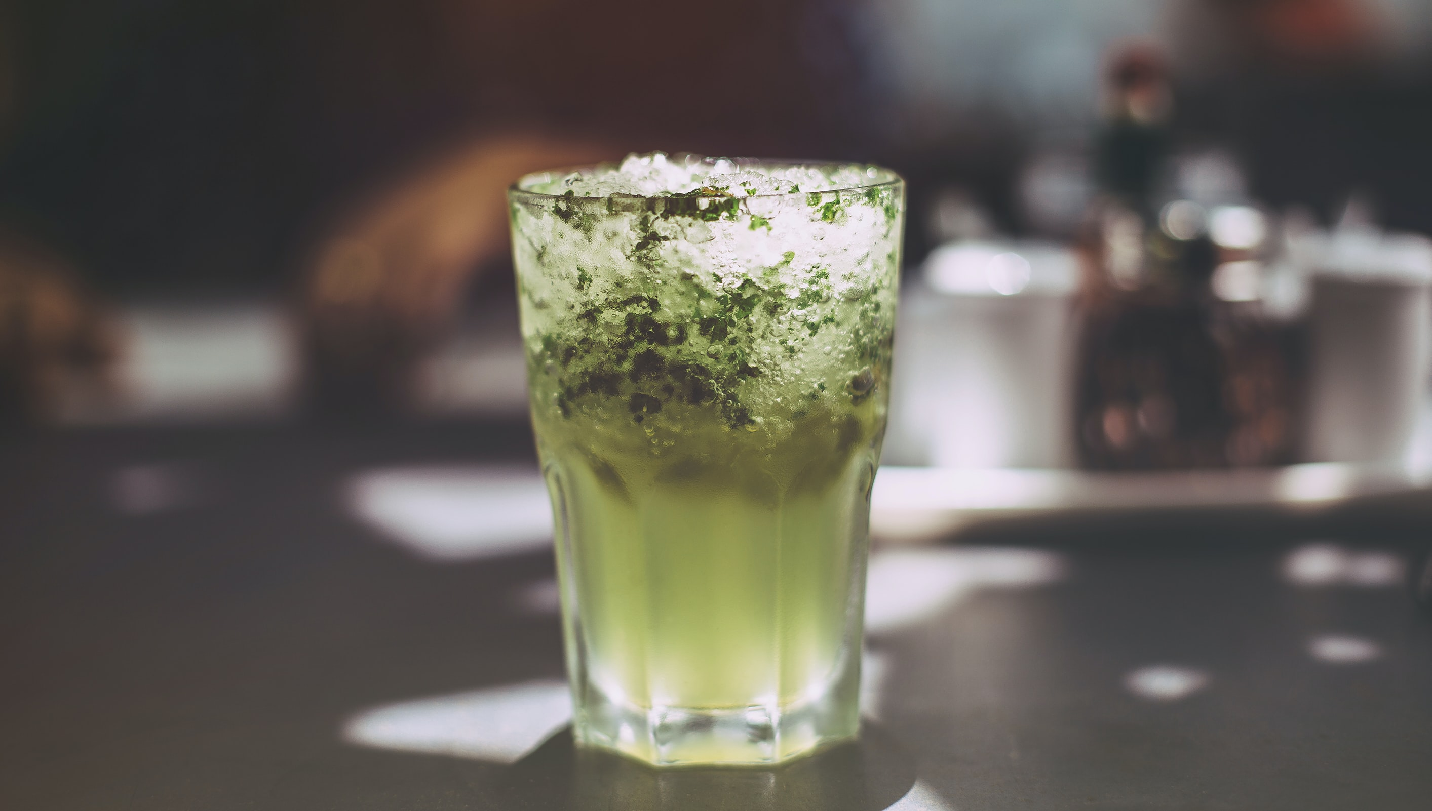 A macro view of a glass cup of cocktail mojito drink in Hyderabad