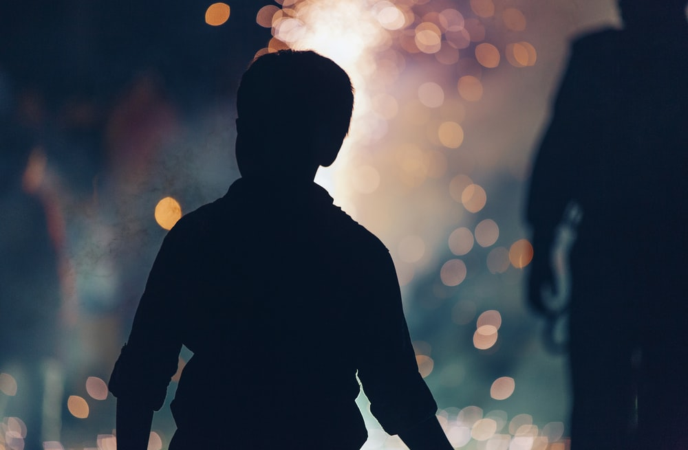silhouette photography of boy beside woman