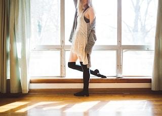 person standing beside window