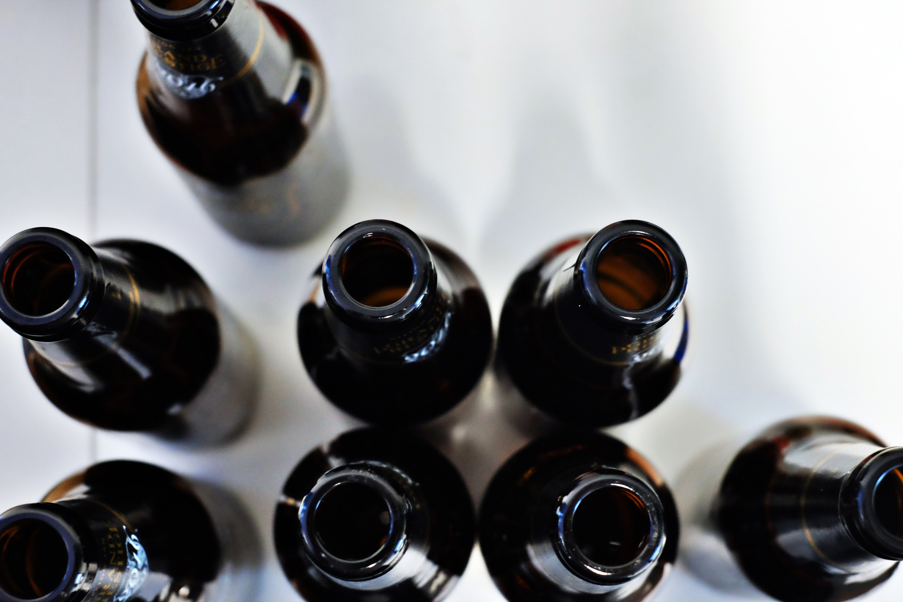 The macro view of the top of open and empty beer bottles