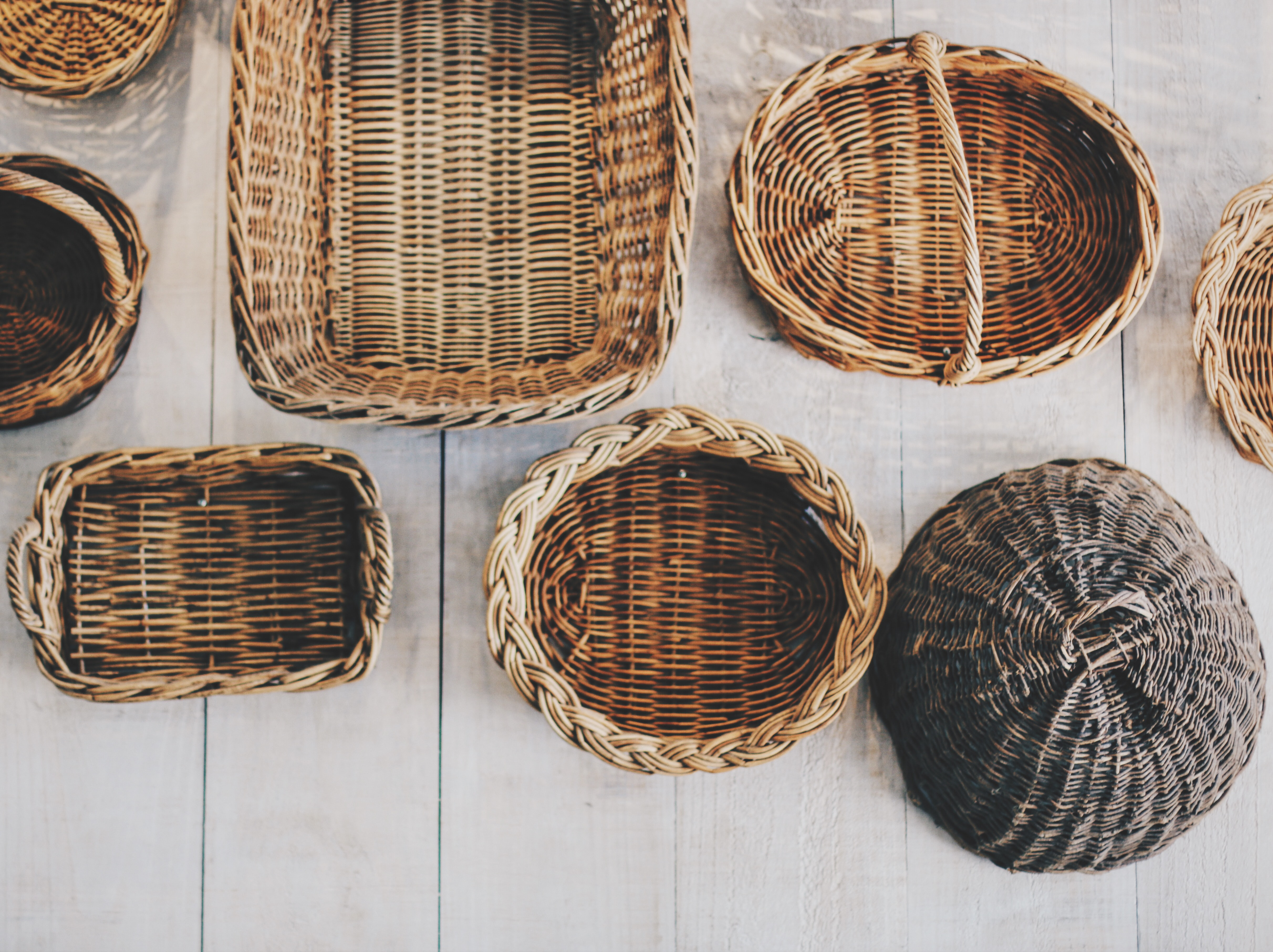 An overhead shot of wicker baskets in various sizes and shapes