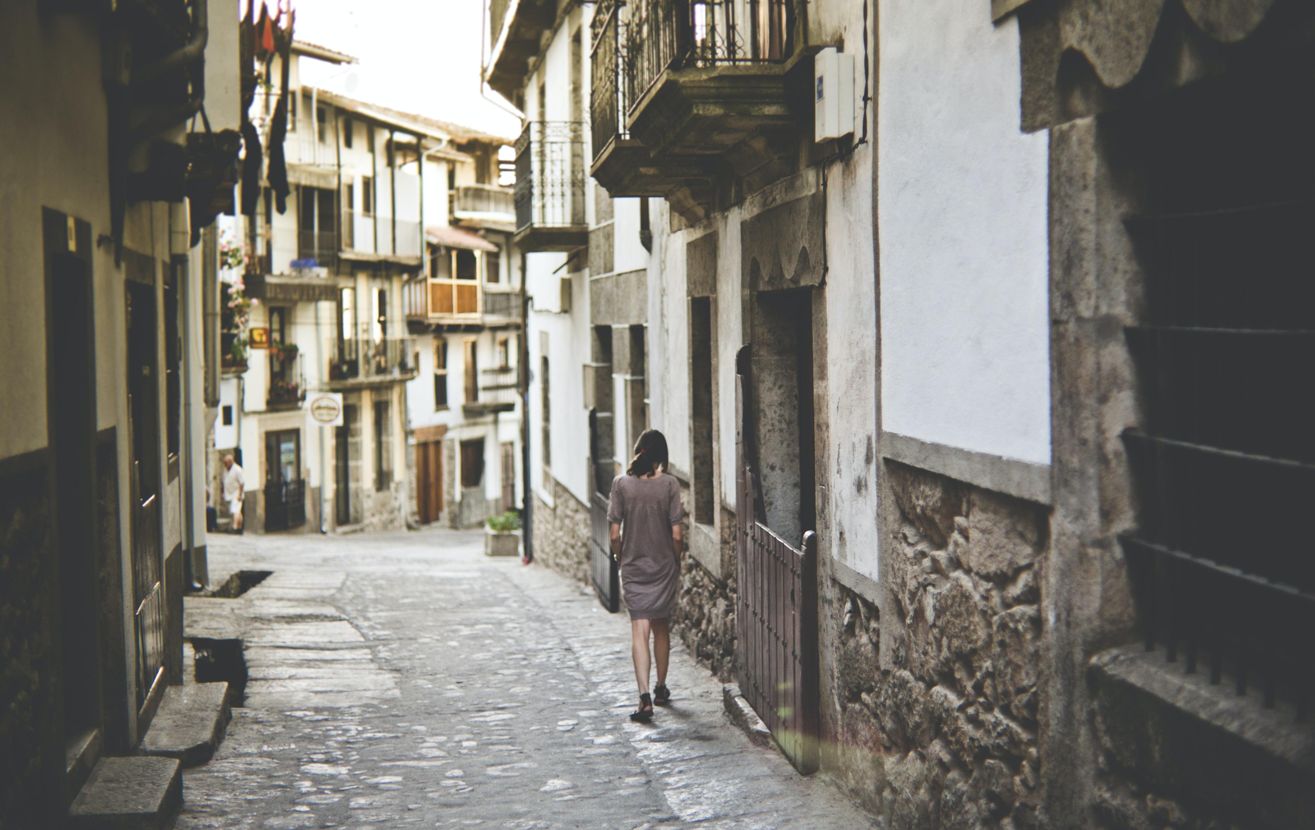 girl walking along pathway