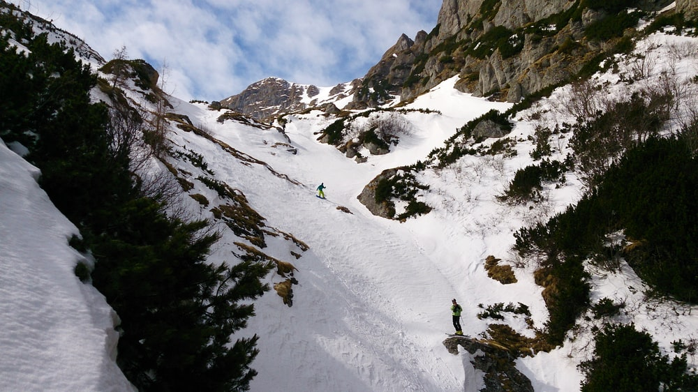 person snowboarding on mountain covered with snow