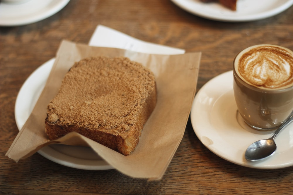 cake on plate and coffee beverage in cup