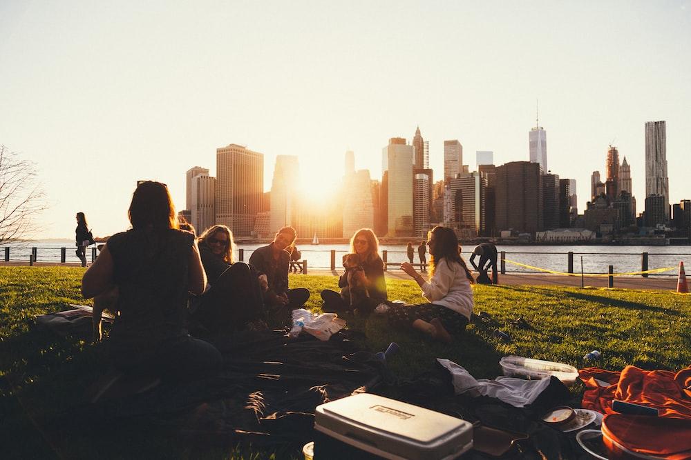 people sitting on grass field