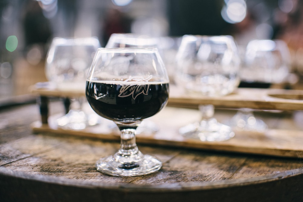 wine glass on brown wooden table