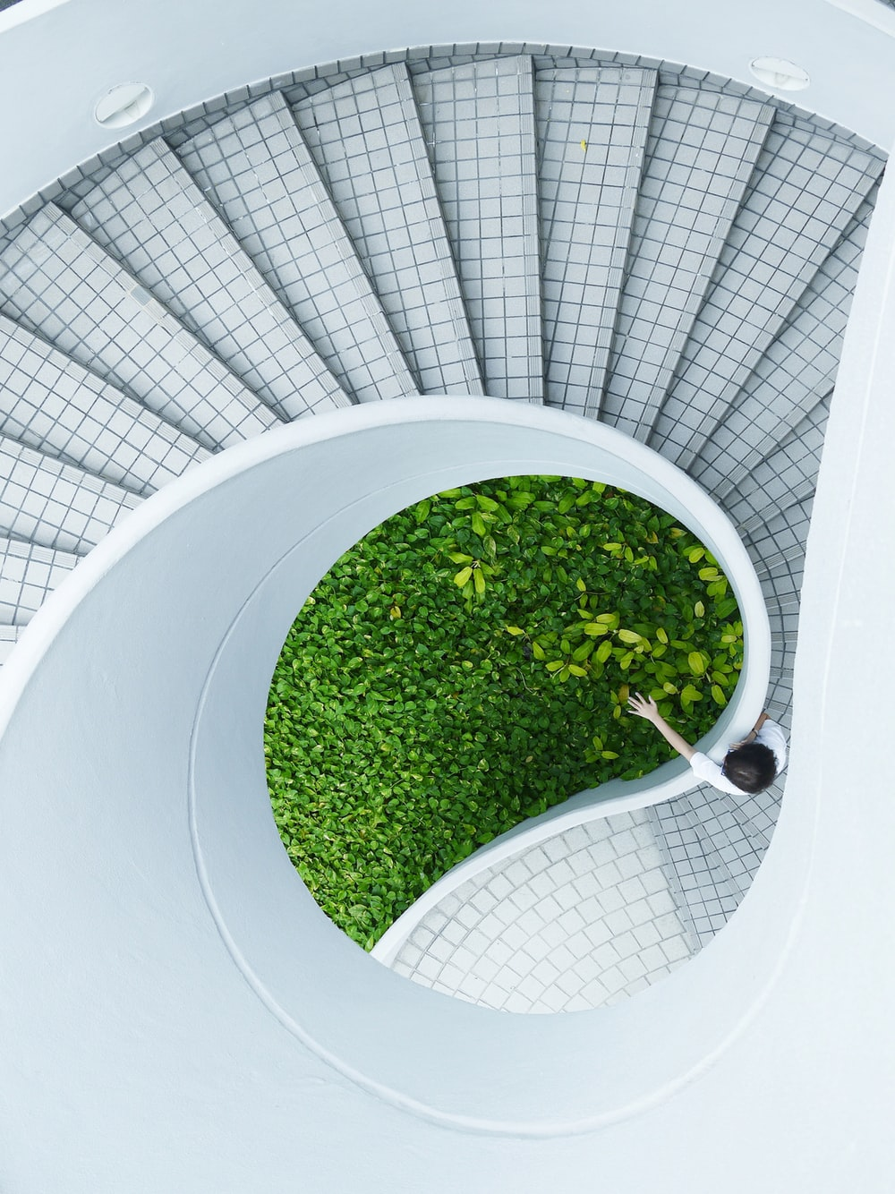 woman standing spiral stairs
