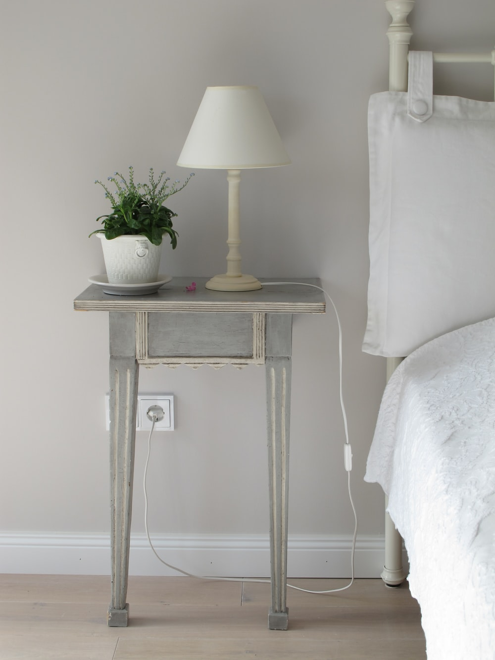 white table lamp on gray end table