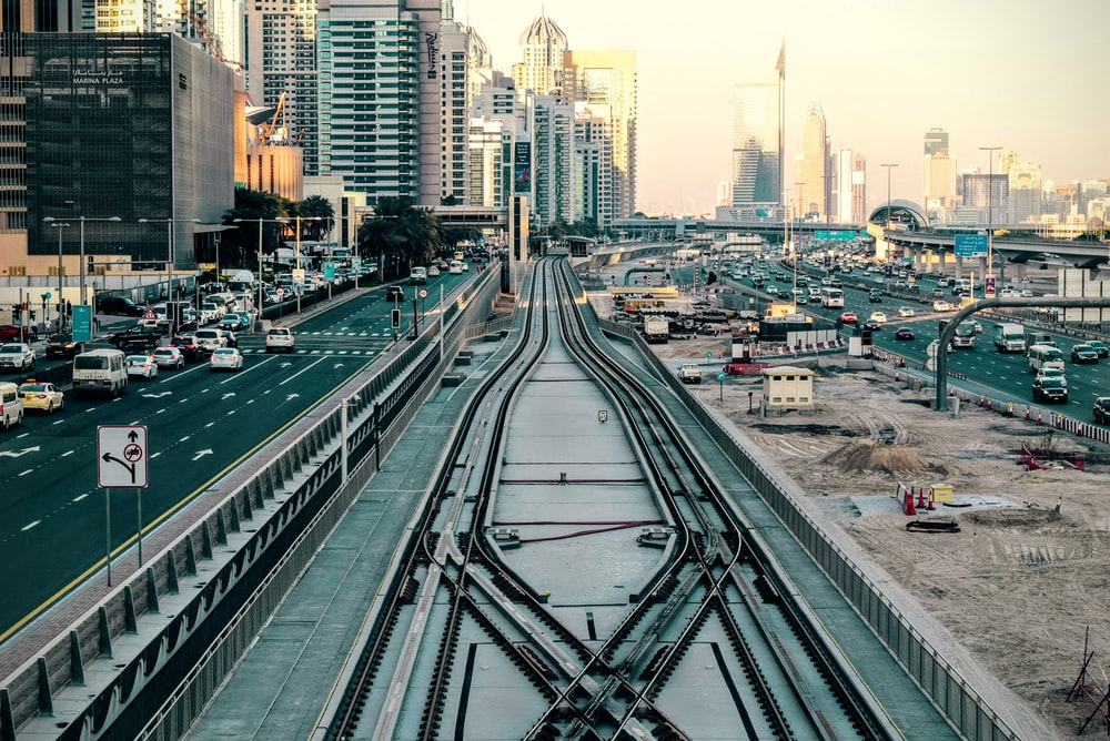 bird's-eye of view of train rail in the middle of city
