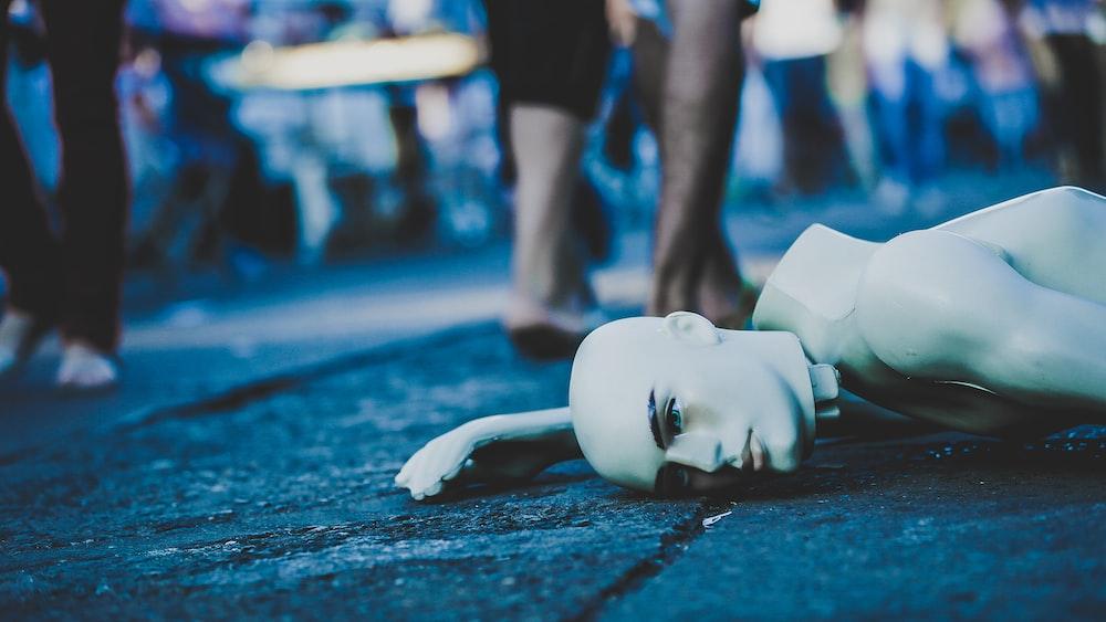 mannequin lying down on floor