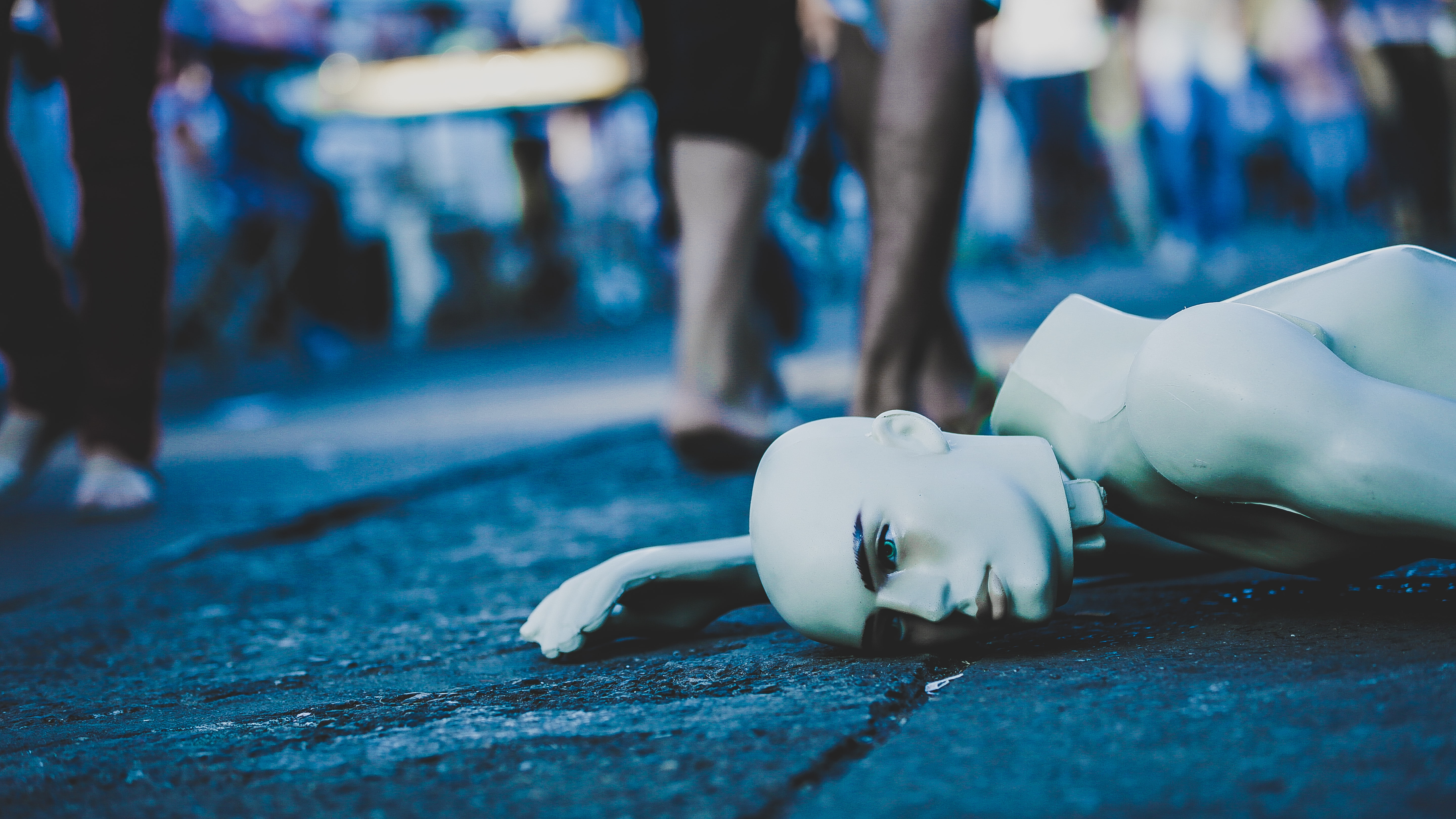 A broken mannequin laying on the street in Taguatinga