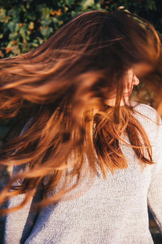 woman waving hair during daytime