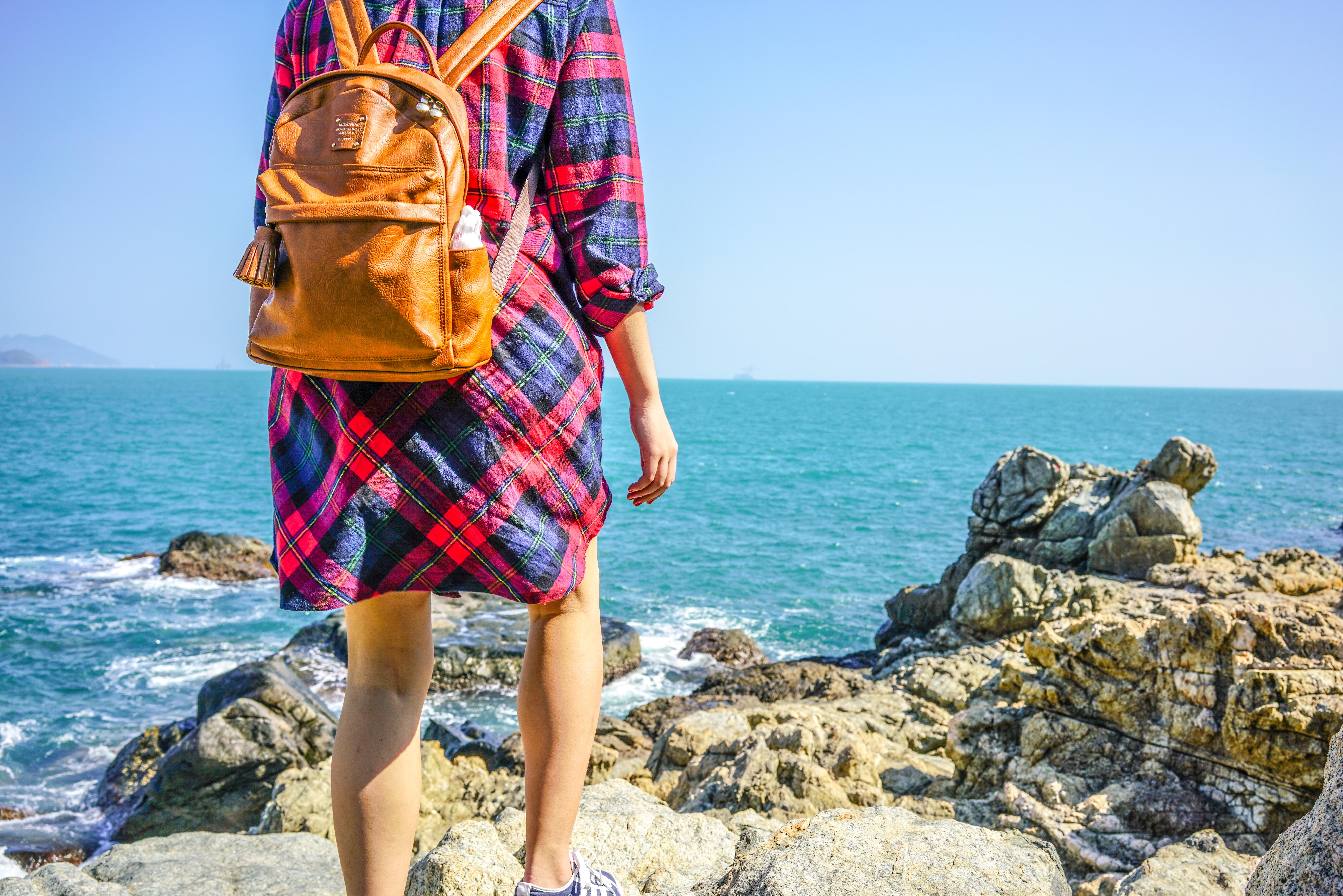 woman standing beside seashore