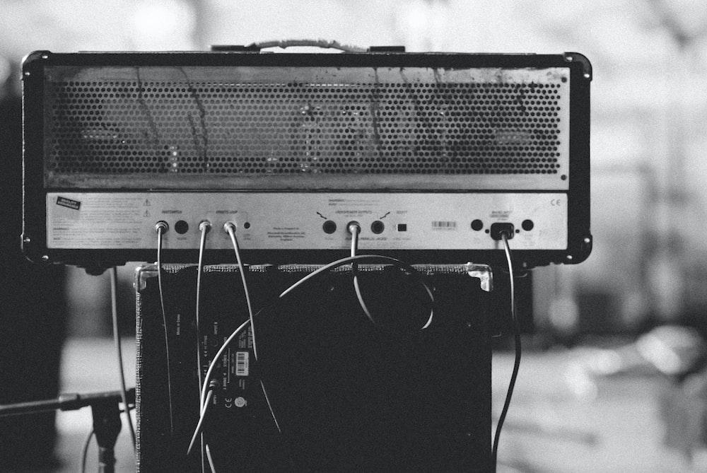 gray and black amplifier on speaker
