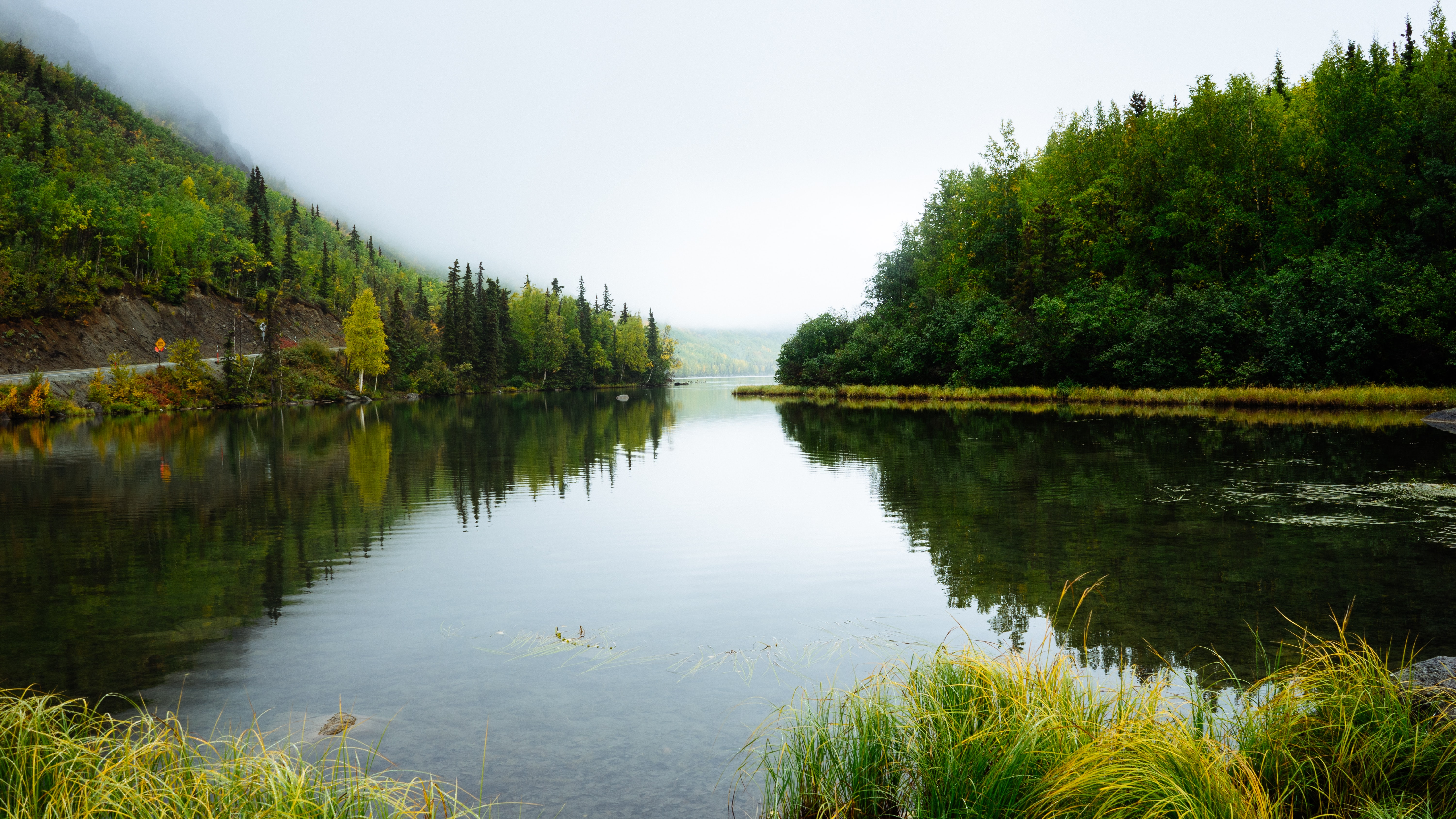 Mist coming down on a quiet lake in Alaska