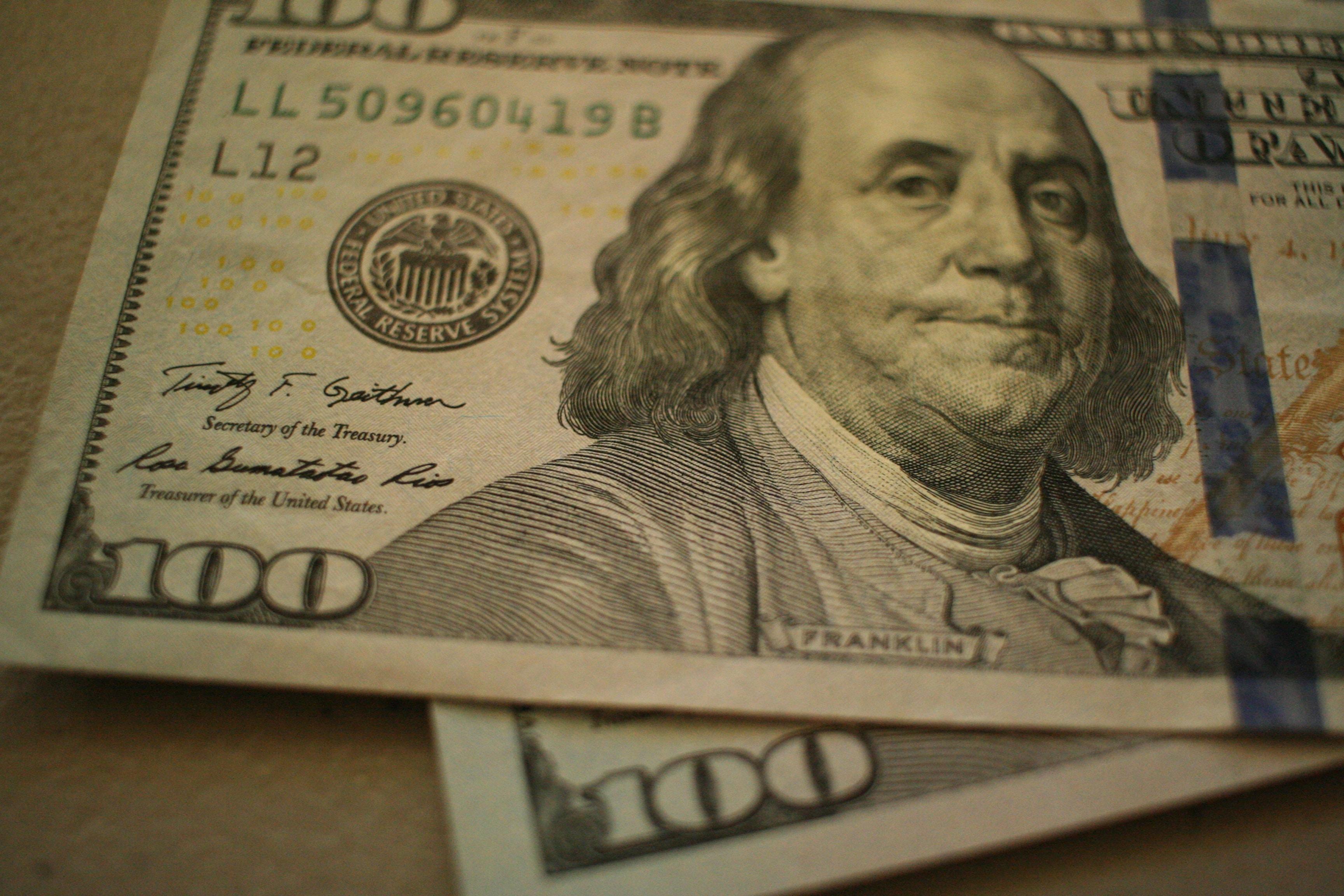 Two $100 bills.