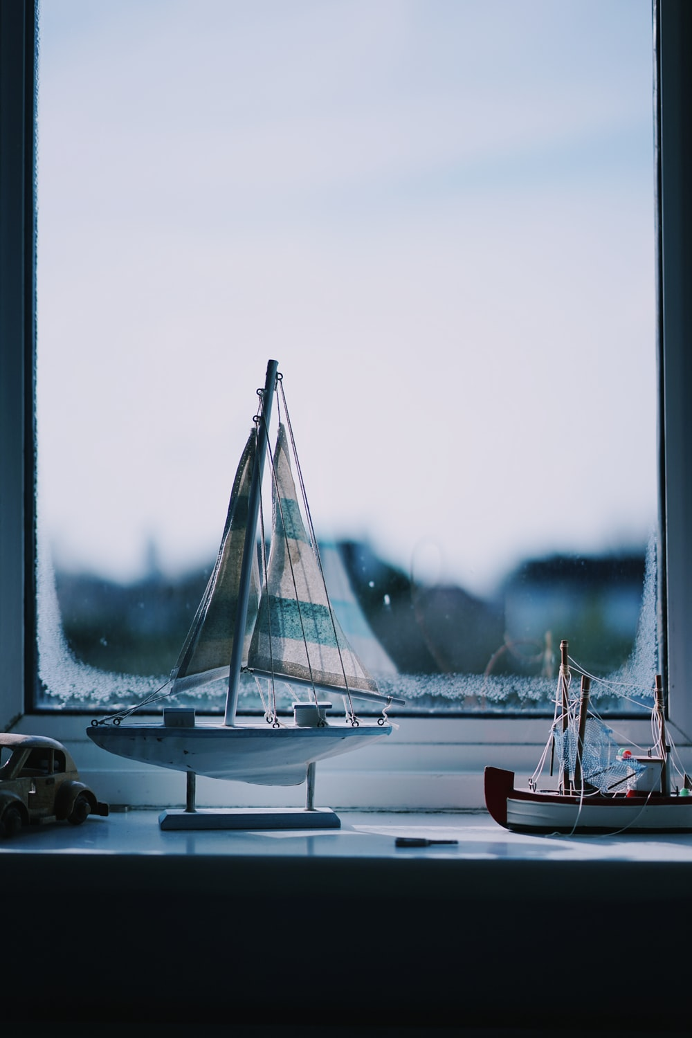 two boat beside window