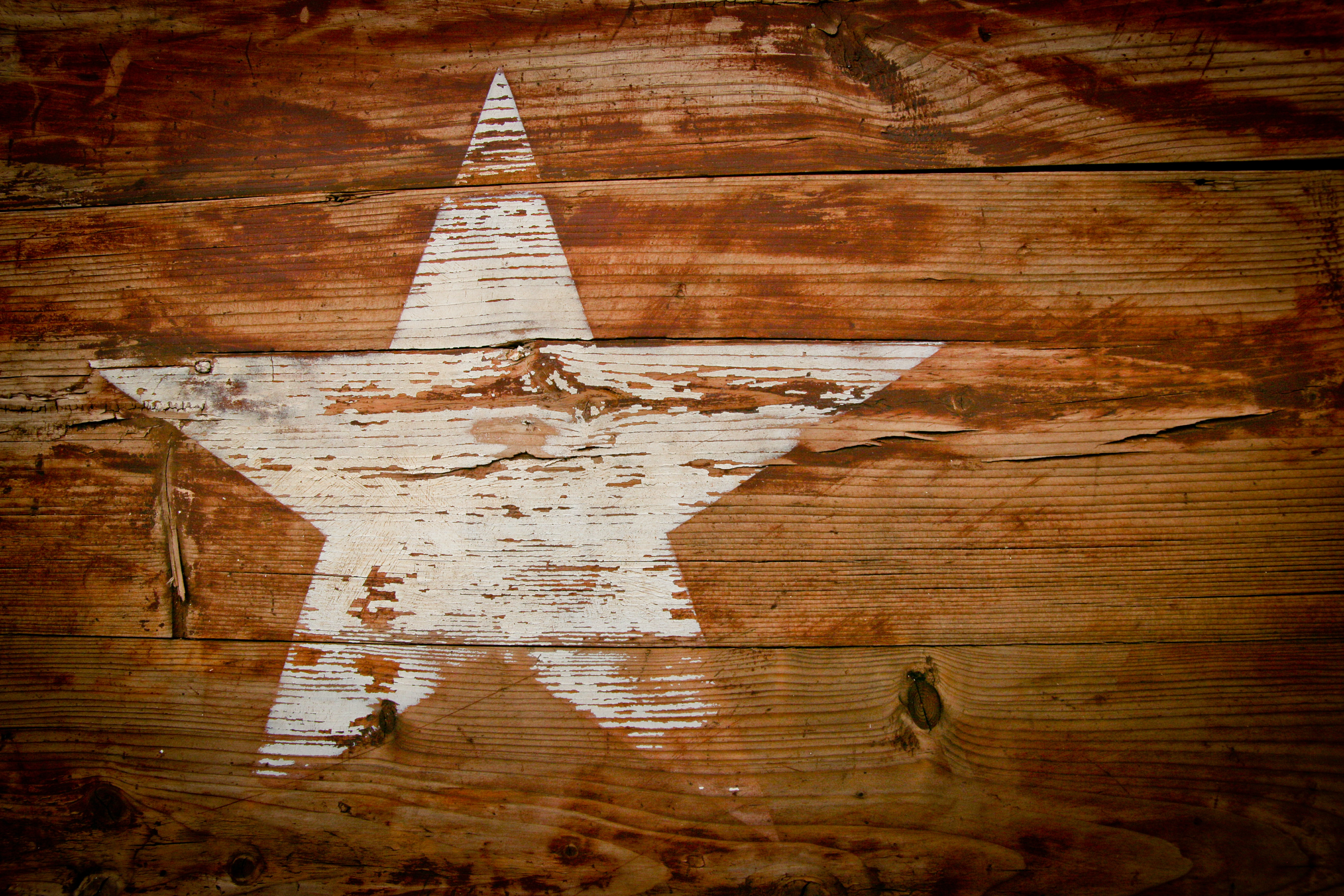 A wooden panel with a white star on it in South Africa