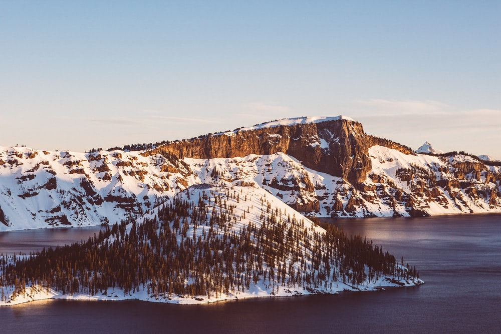 snow covered islet at daytime