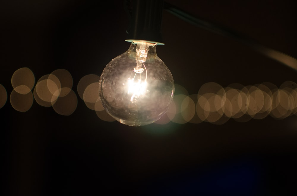 black and clear LED bulb with bokeh lights