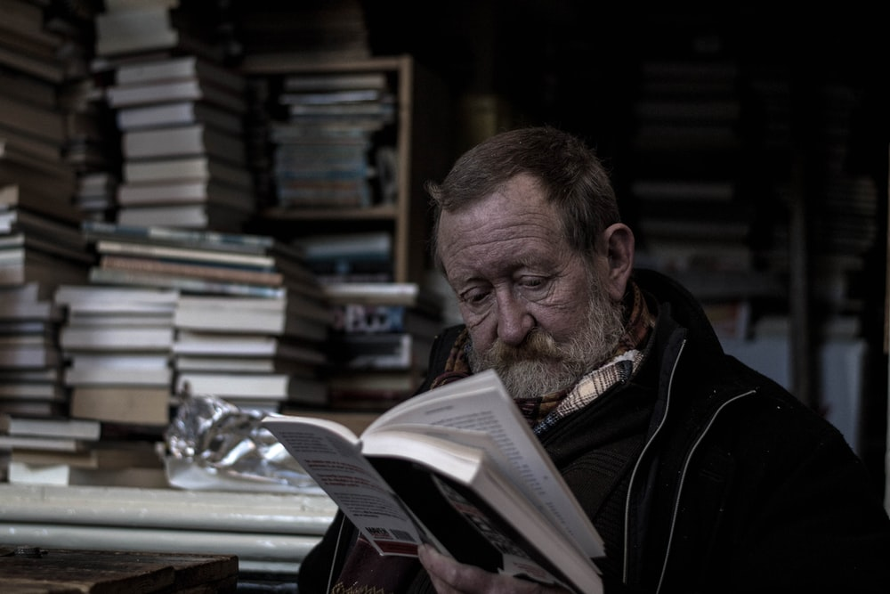 man reading a books
