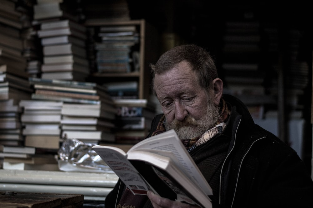 man reading a books
