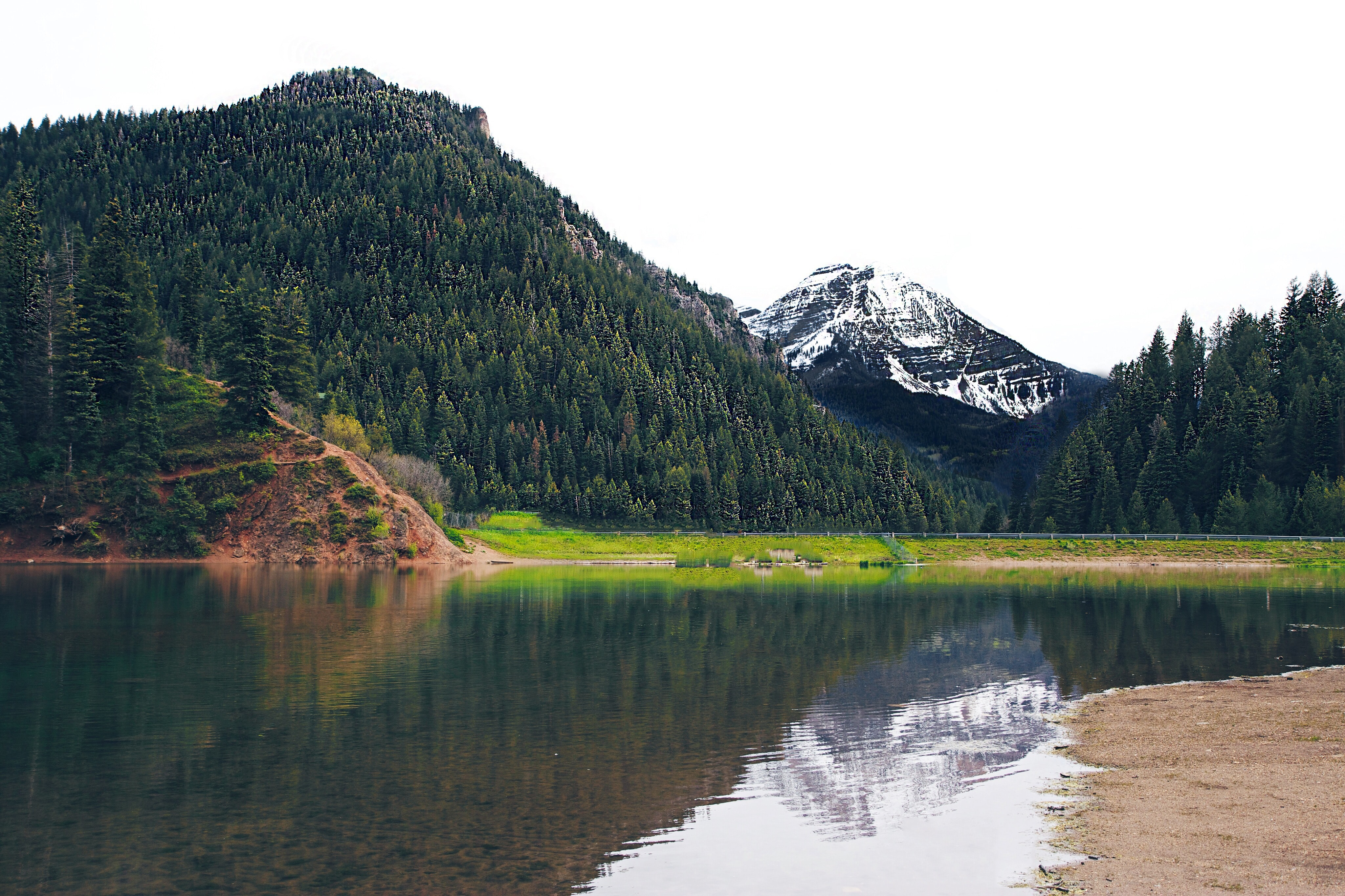 A snowy mountain reflected in a lake