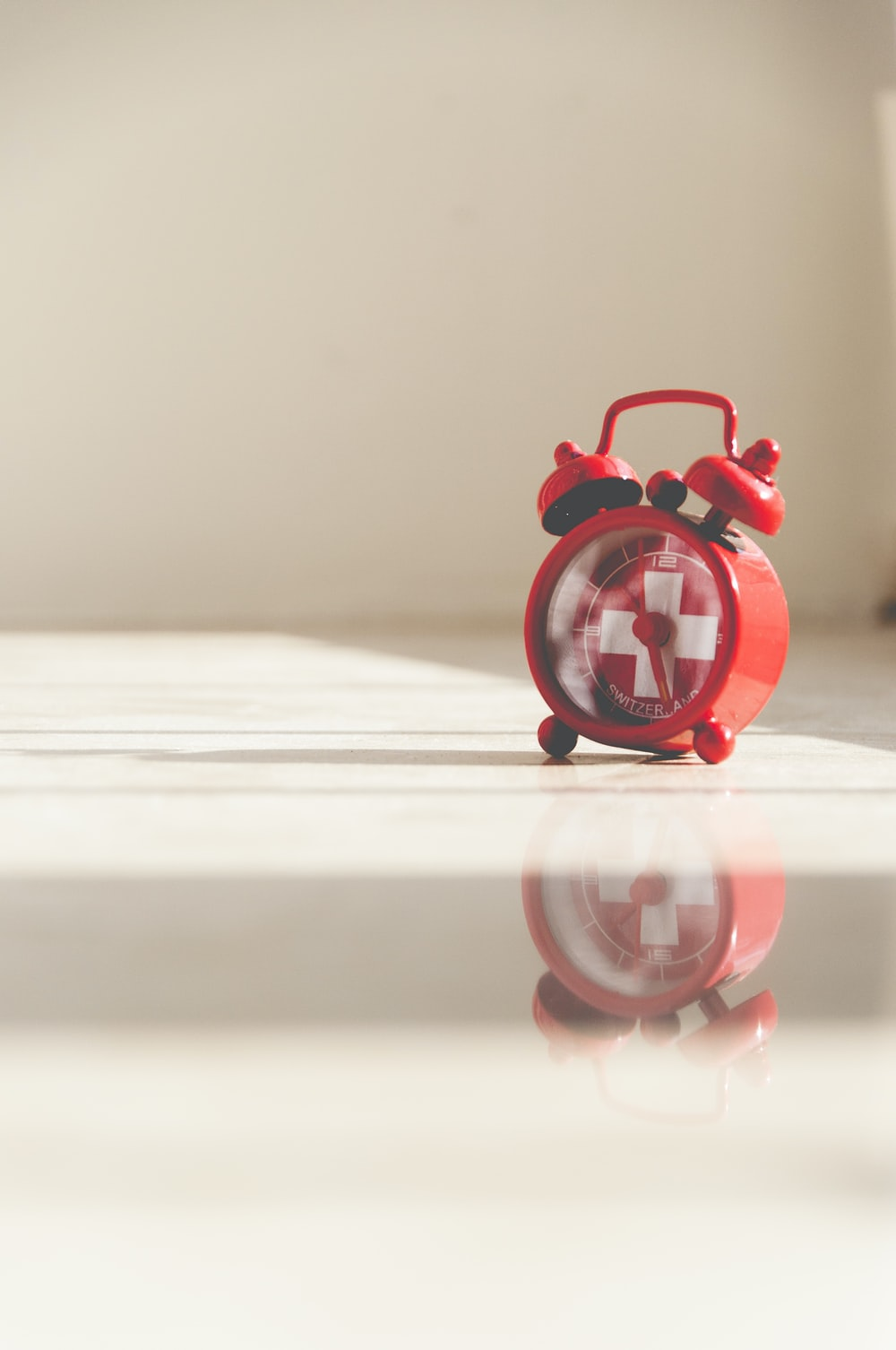 red twin bell alarm clock