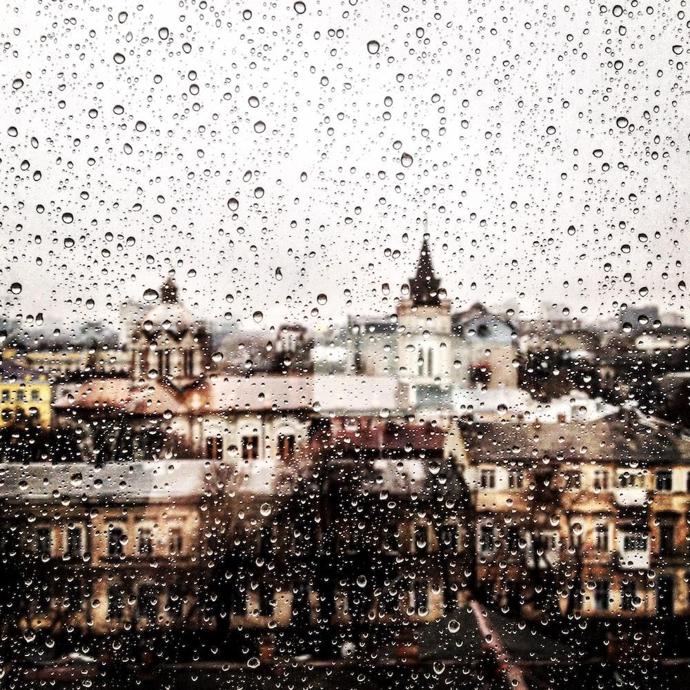 clear glass window with tear drop rain