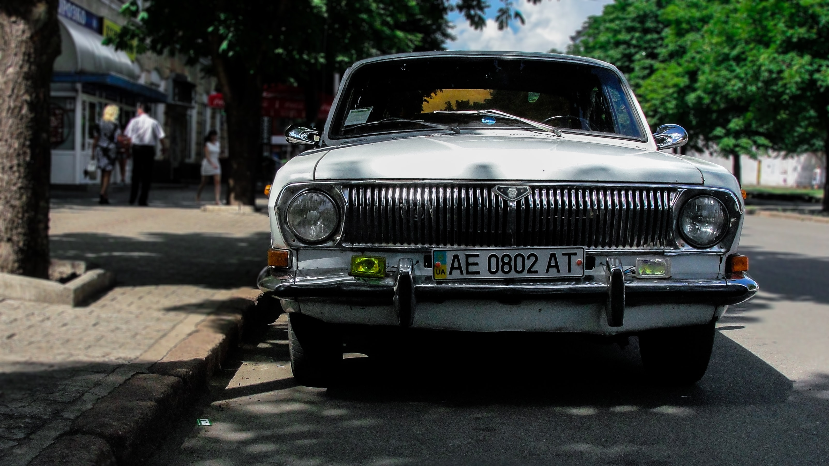 Front of vintage white car on parked on pavement in Kryvyi Rih