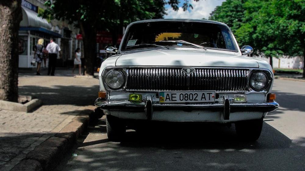 white car on road