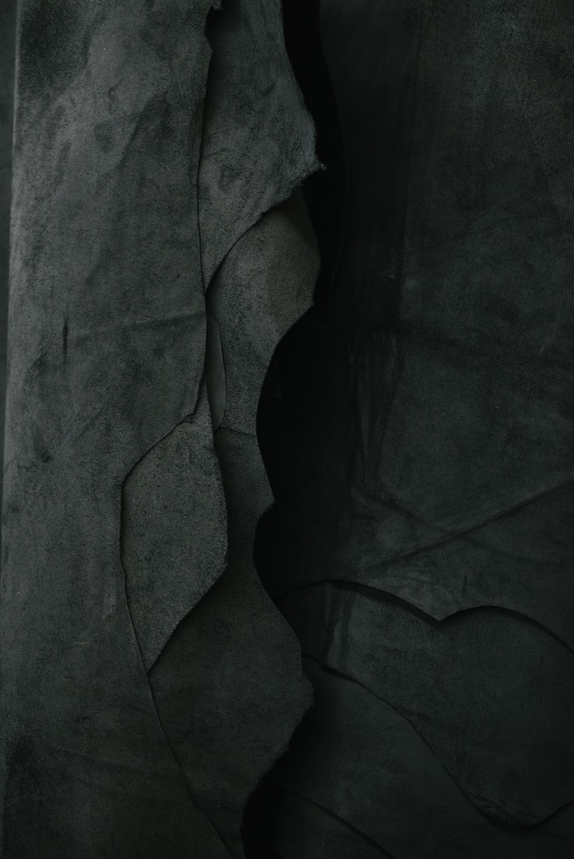 Darkened image of a rock wall.