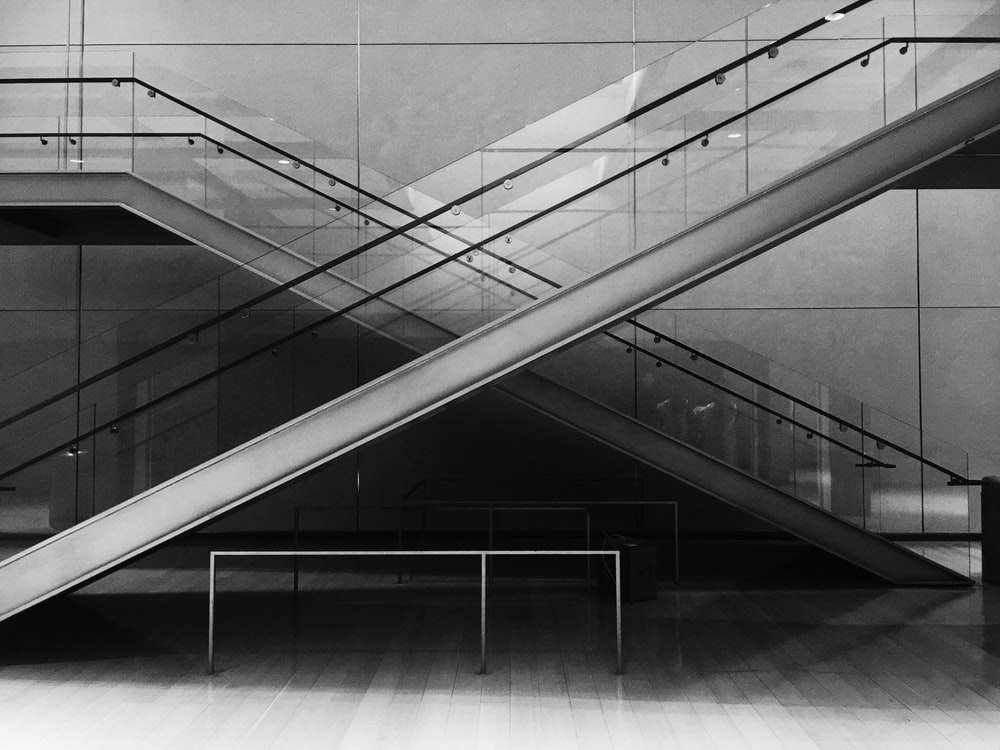 grayscale photo of glass stairs