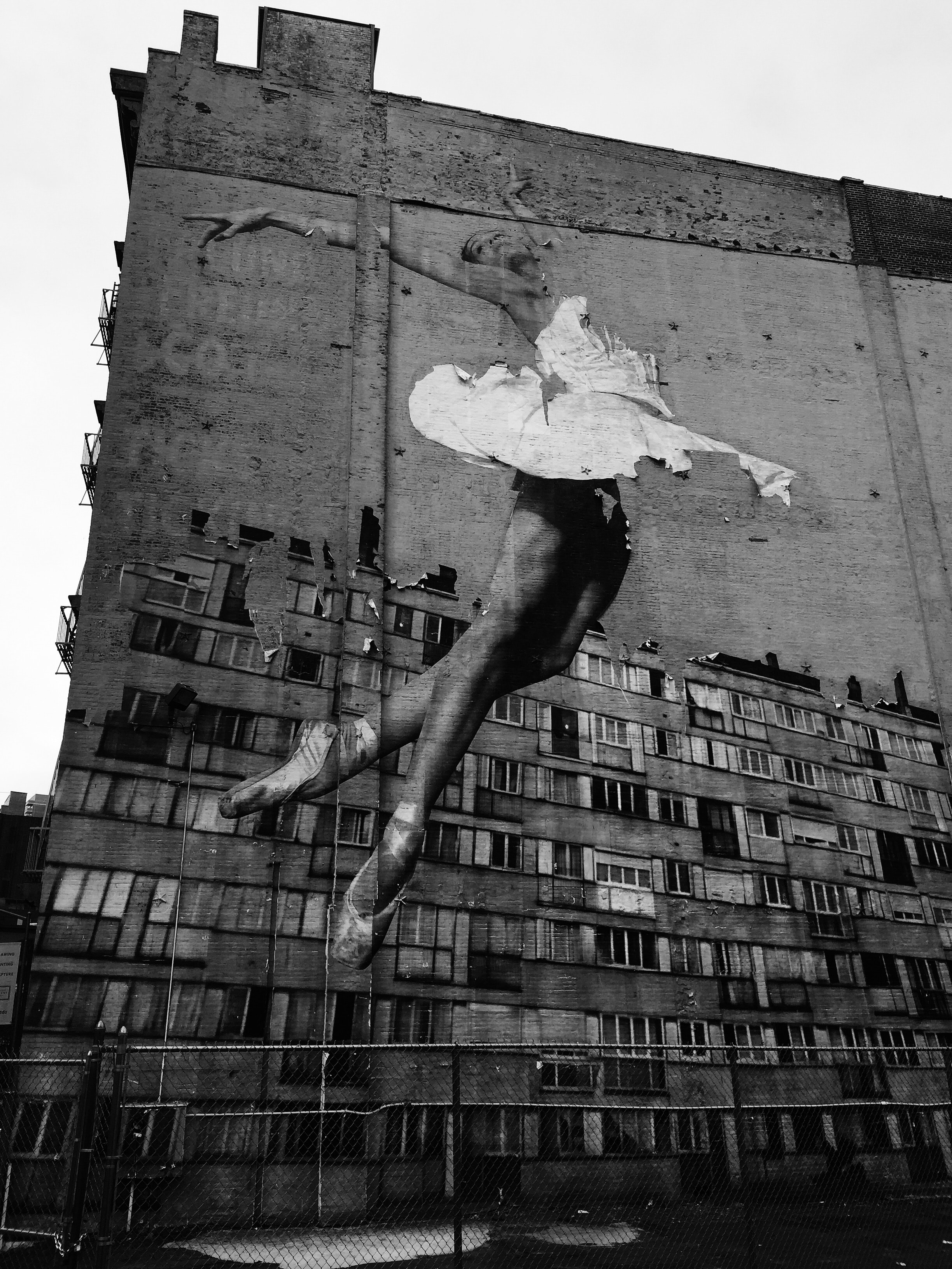 A ballet dancer painted on a large abandoned building.