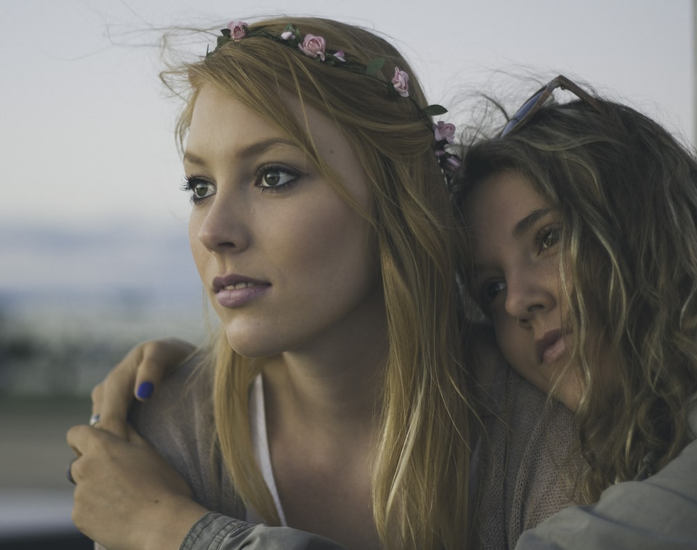 two women close up photography