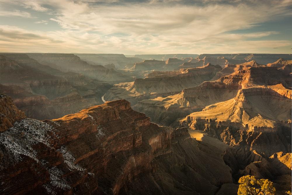 grand canyon below cloudy sky