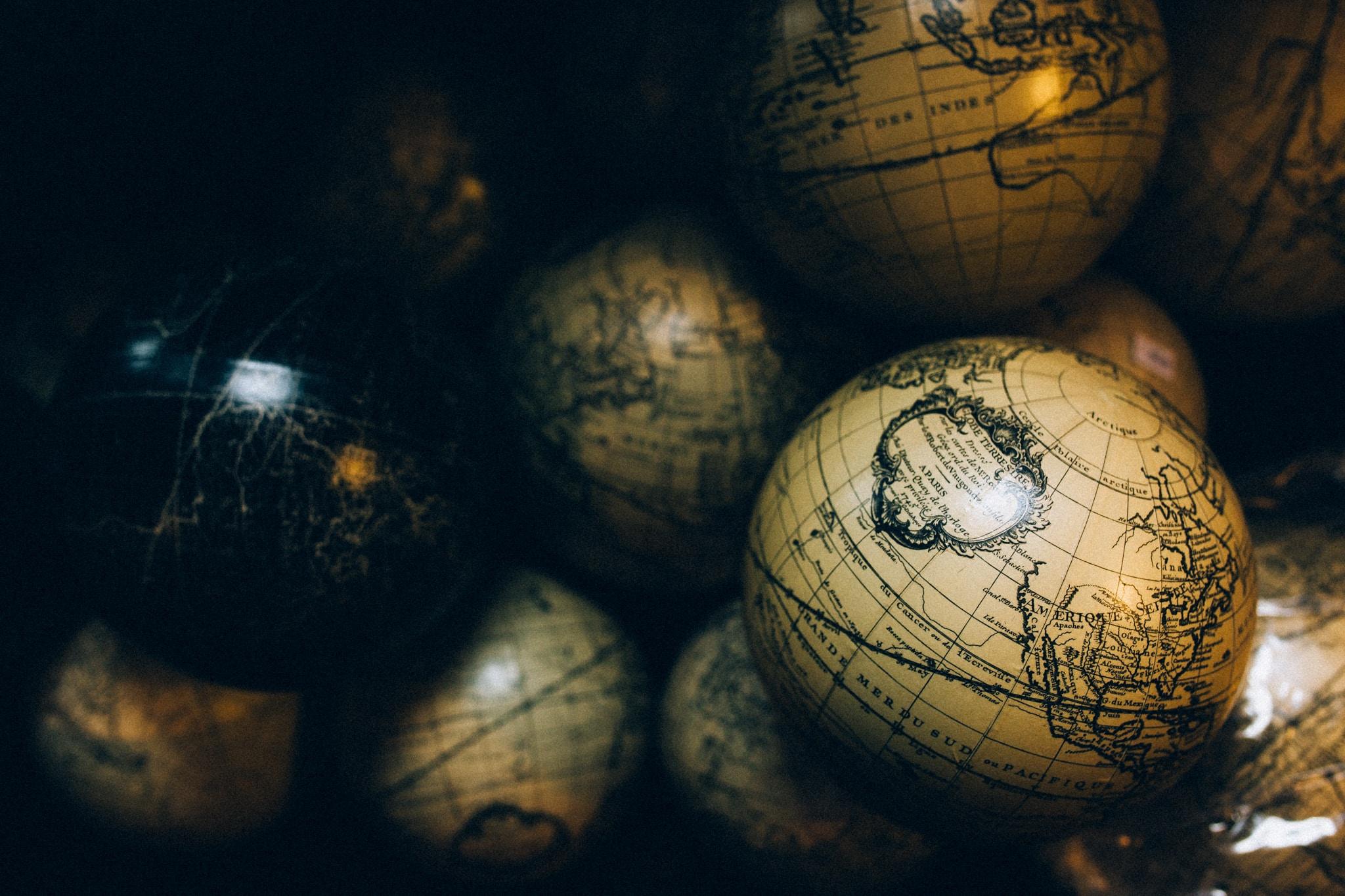 round beige and black globe decors