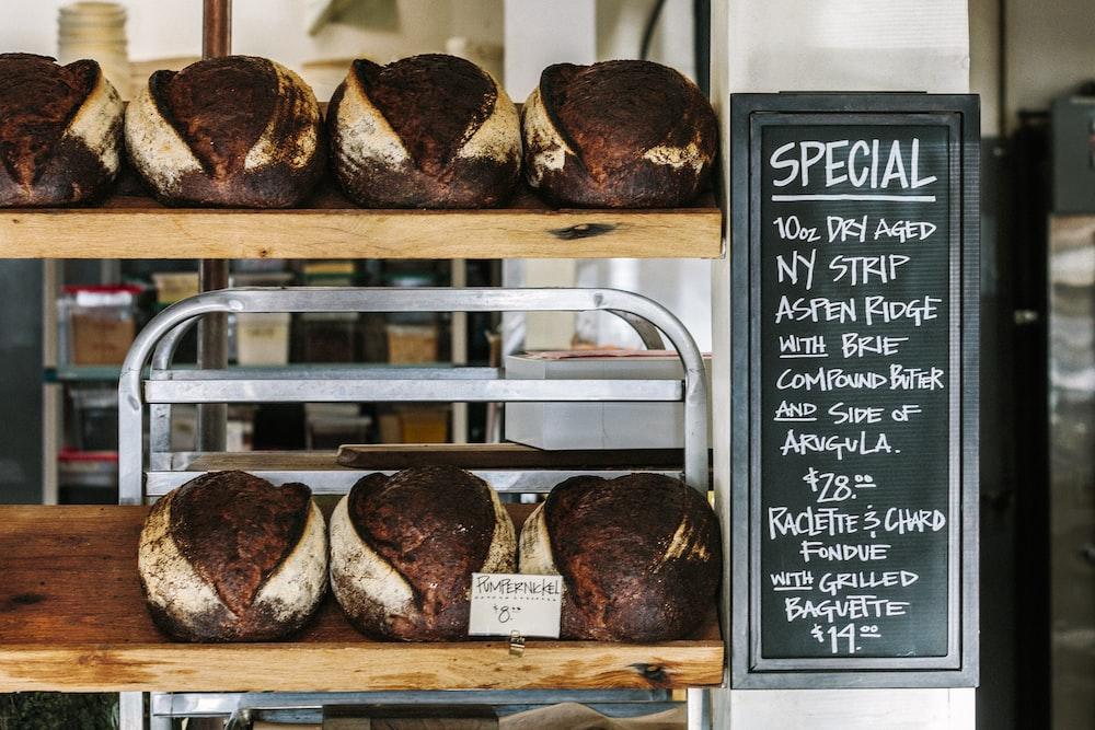 breads on brown wooden shelf